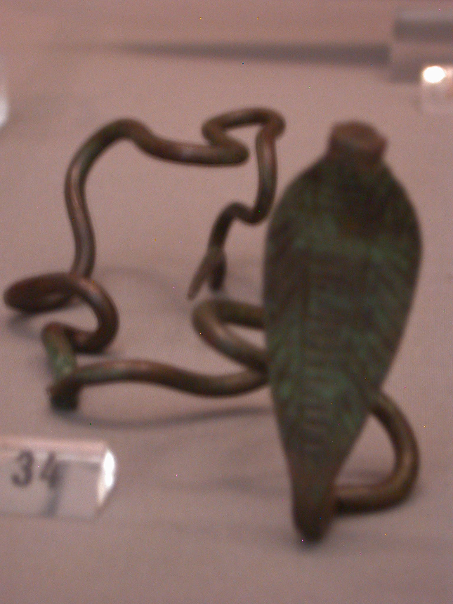 Cobra Wand Found With Magical Texts and Implements in Tomb 5 Under the Ramesseum, Copper Alloy, Middle Kingdom, 2119-1794 BCE, Thebes, Egypt, in Fitzwilliam Museum, Cambridge, England