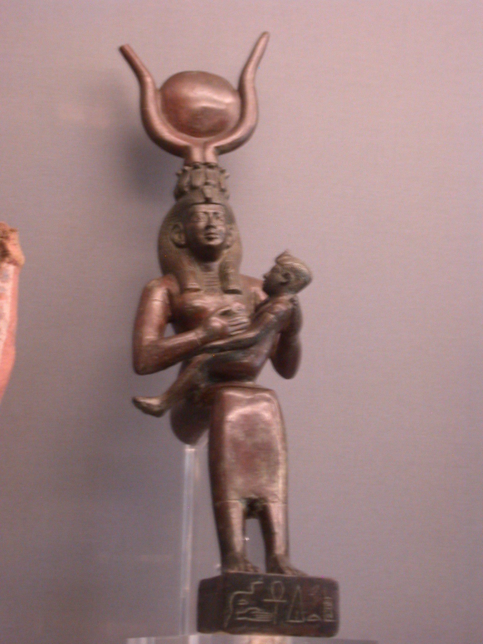 Figure of Isis and Horus Dedicated to Hatiufankh on the Base, Copper Alloy, About 200-100 BCE, Egypt, in Fitzwilliam Museum, Cambridge, England