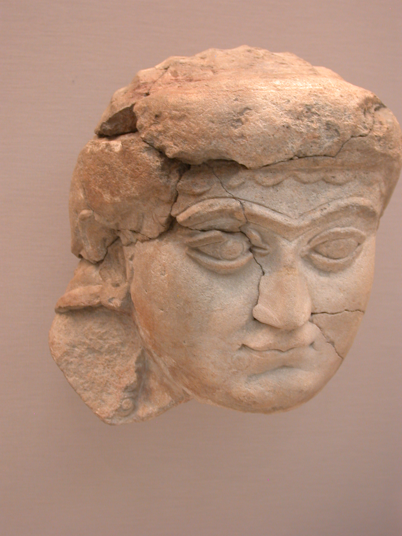 Head of a Woman, Gypsum Wall Panel, About 700-625 BCE, Probably Nineveh, Assyria, in British Museum, London, England
