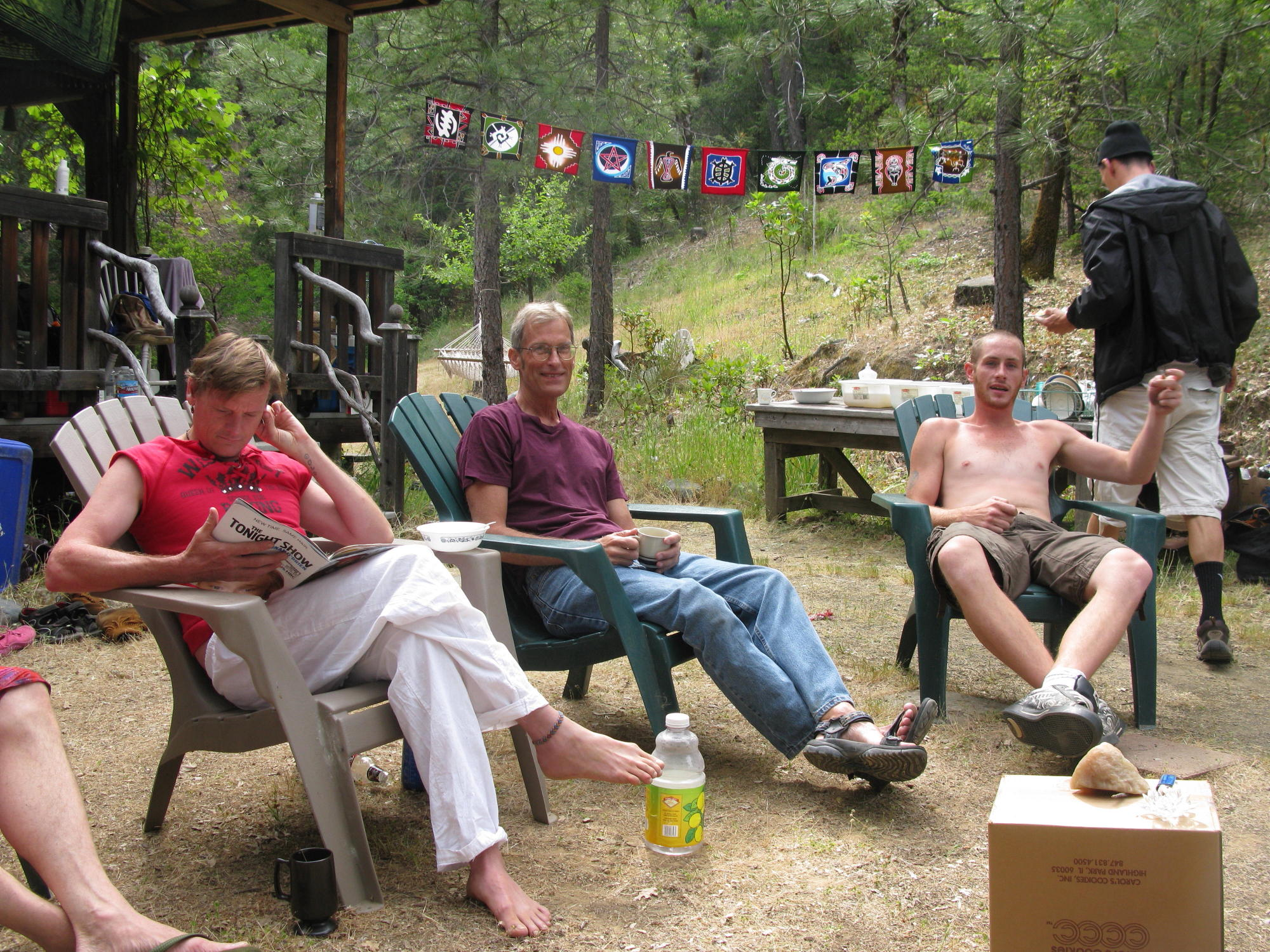 Mitcho Randy and Josh Sitting in Front of Cabin, Covelo Yoga and Healing Festival
