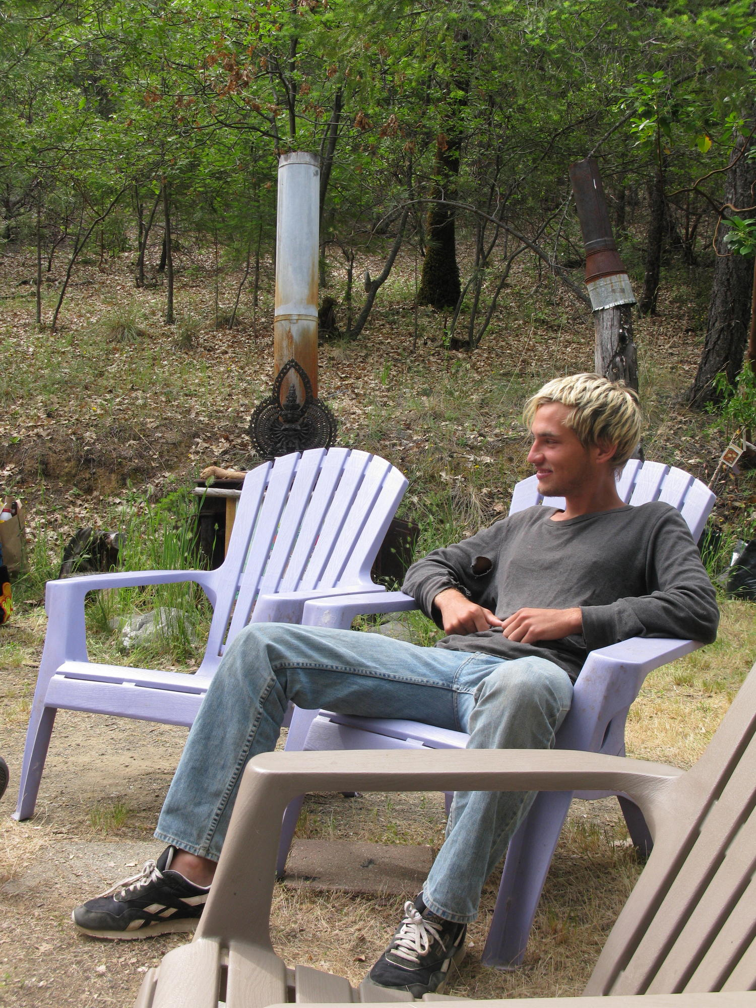 Damon Sitting in Front of Cabin, Covelo Yoga and Healing Festival