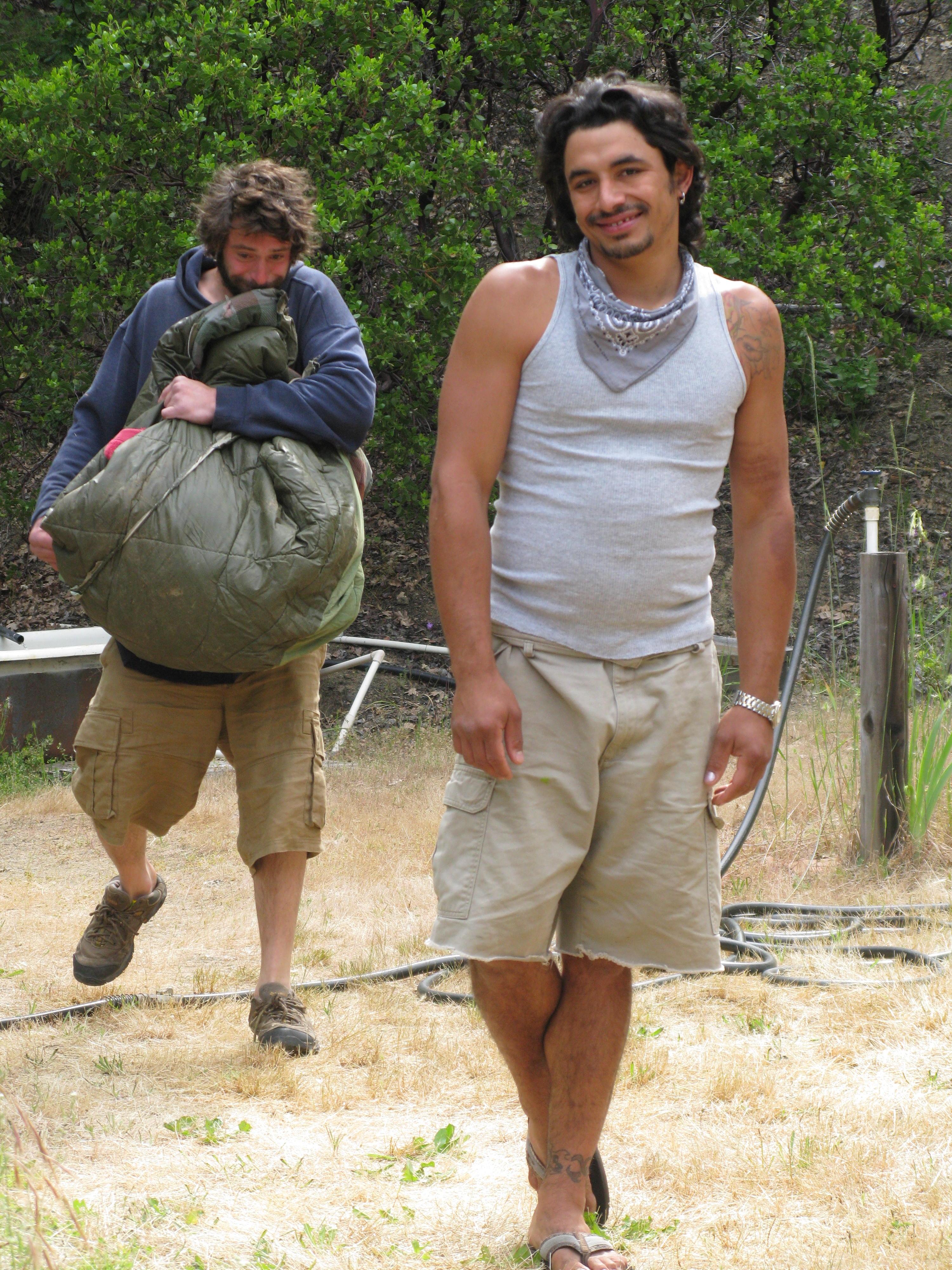 Robert and Josiah Walkng Toward Cabin, Covelo Yoga and Healing Festival