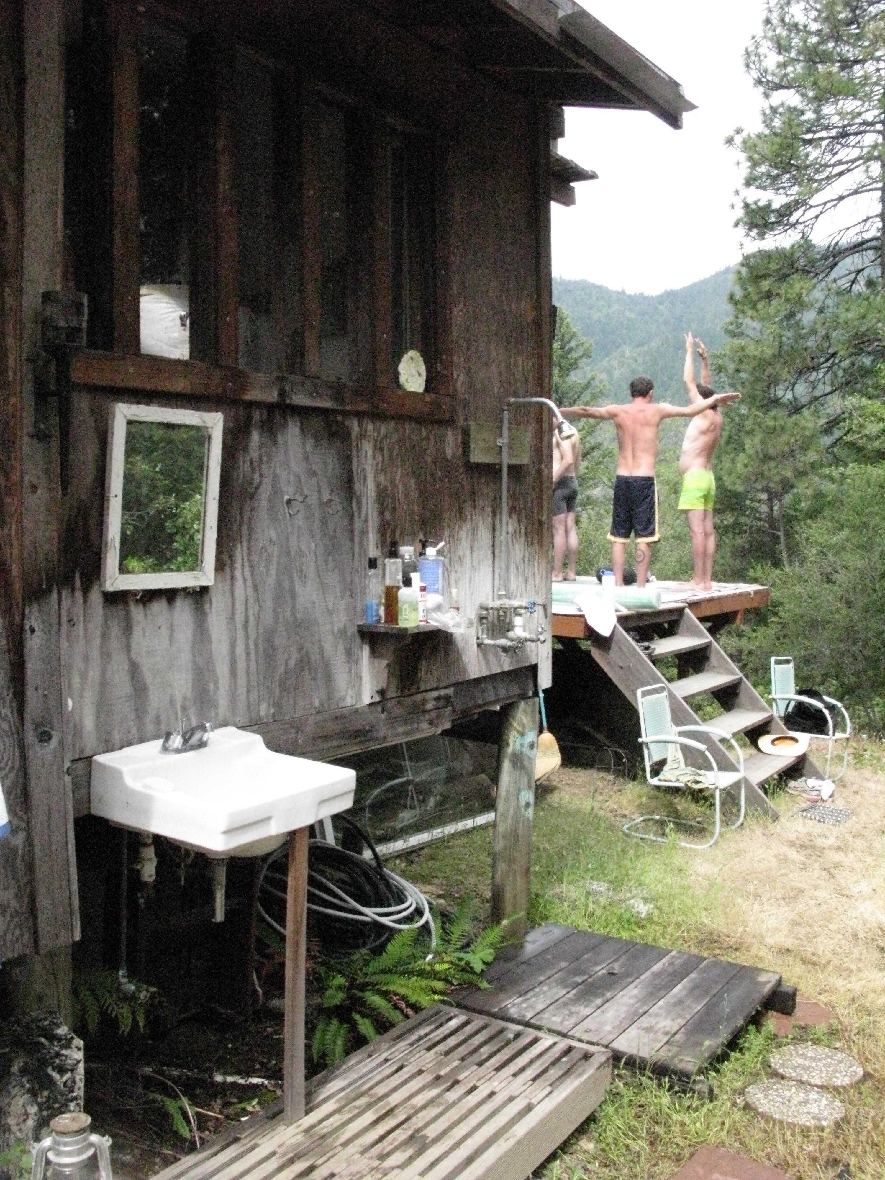 Forest Reflection in Mirror of Outdoor Bathhouse at Cabin, Covelo Yoga and Healing Festival